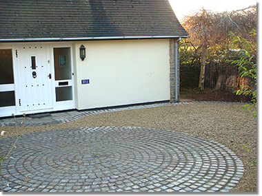 Driveway with reclaimed granite cobble setts